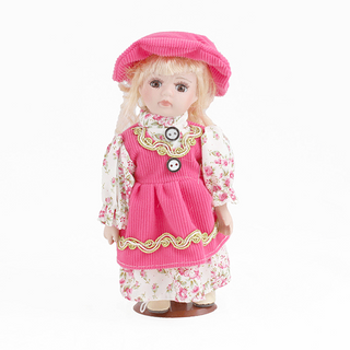 Porcelain doll Girl in pink sundress