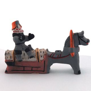 Kargopol clay toy Man with firewood on the sled