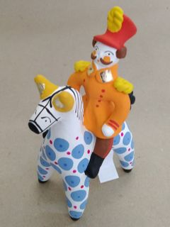 Hussar on a horse with a blue color, Dymkovo clay toy
