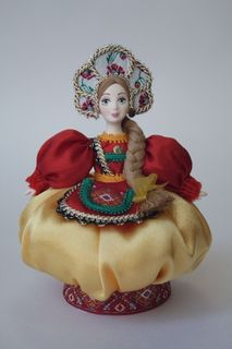Doll gift porcelain. Tumbler. The costume is based on Russian clothing.