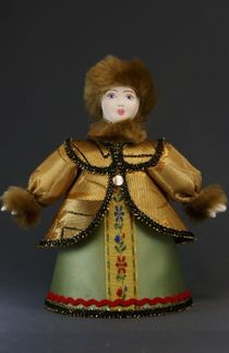 Doll gift porcelain. The woman in the winter suit. The beginning of the 19th century. Russia.