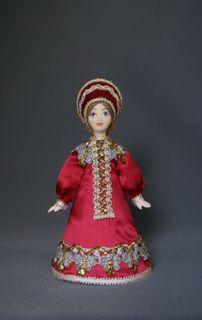 Doll gift porcelain. Arkhangelsk region, Russia. Maiden costume.