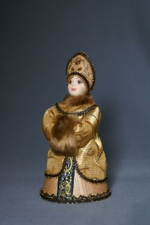Doll gift porcelain. The Russian boyar's daughter in winter clothes (styling).