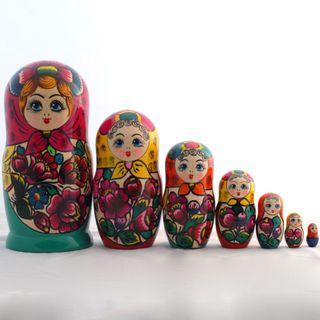 Matryoshka in crimson scarf of 7 dolls Polkhovsky Maidan