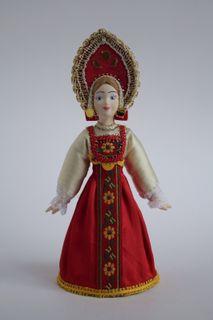 Doll gift porcelain. Maiden costume.