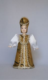 Doll gift porcelain. A woman in a stylized Russian costume. 18-19 centuries.