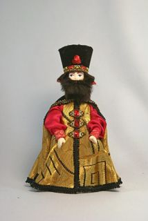 Doll gift porcelain. A nobleman in traditional clothing (styling). 17th century. Rus.