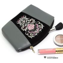 Leather cosmetic bag rose grey color with silver embroidery