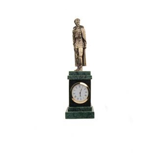 The statue of Dzerzhinsky on a stand with clock