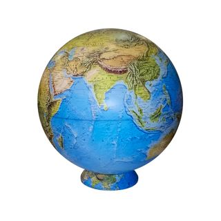 A large physical desktop globe map on a stand