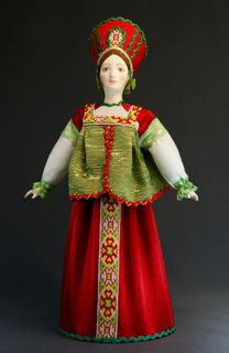 Doll gift porcelain. Traditional peasant maiden costume. Russia.