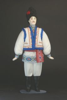 Doll gift porcelain. Bessarabia. Moldovan in festive national costume.