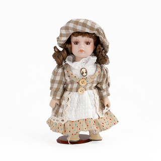 Porcelain doll Girl brown dress in a cage