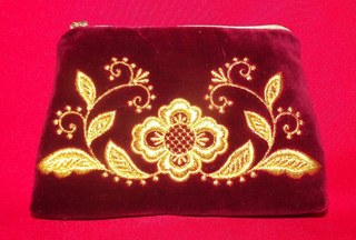 Velvet cosmetic bag with gold embroidery in gold red
