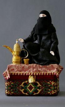 Arab with coffee maker. Box.