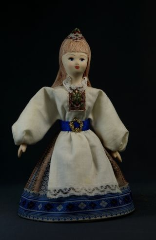 Doll gift porcelain. Stone. Women's traditional costume. Late 19th - early 20th century.