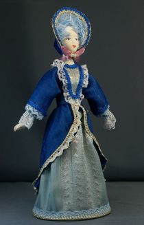 Doll gift porcelain. The St. Petersburg lady in walking costume. Mid-18th century European fashion.