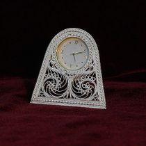 Clock on an oval base
