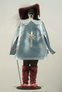 Doll gift. The Royal musketeer. 16th century. France. Military uniform
