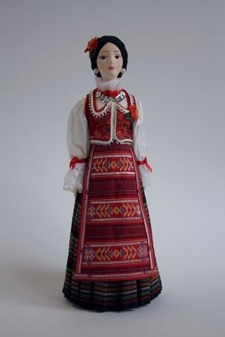 Doll gift. Stylized female national costume. Serbia