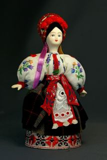 Doll gift porcelain. Maiden Ukrainian costume.