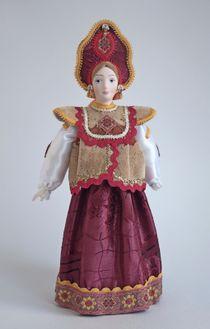 Doll gift. Russian folk costume with dushehra
