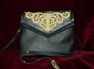 Handbag made of genuine leather with gold embroidery black