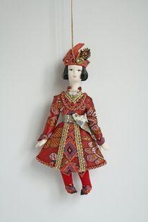 Doll pendant souvenir porcelain. Prince