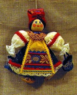 Doll-poteshka gift pendant. The water-bearer. Wood, textiles.