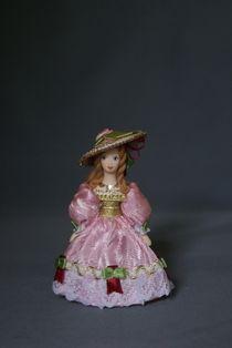 Doll pendant souvenir porcelain. Is that woman.