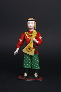 Doll gift porcelain. The balalaika. Costume on motives of Dymkovo toys.