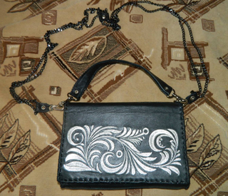 Genuine leather clutch with silver embroidery black