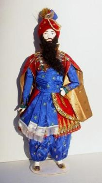 Doll gift. The costume of the Shah for the ballet 'Shaherezada' Bakst