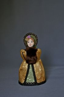 Doll gift porcelain. Girl in coat and bonnet. 19th century Russia. The European fashion.