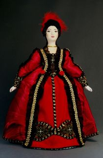 Doll gift porcelain. Secular suit with a red Esprit. The beginning of the 18th century.