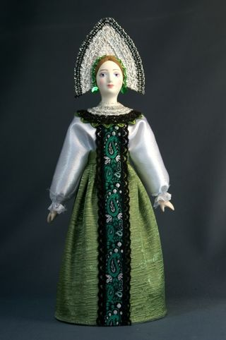 Doll gift porcelain. Girl in traditional Russian clothes. Late 19th - early 20th century.