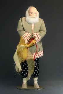 Doll gift porcelain. The old man with a goldfish. Fairy tale character.