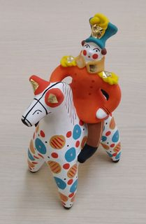 Horseman on a horse in a red officer tunic, Dymkovo clay toy