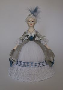 Doll gift porcelain. Women's court costume of the mid 18th century. France.
