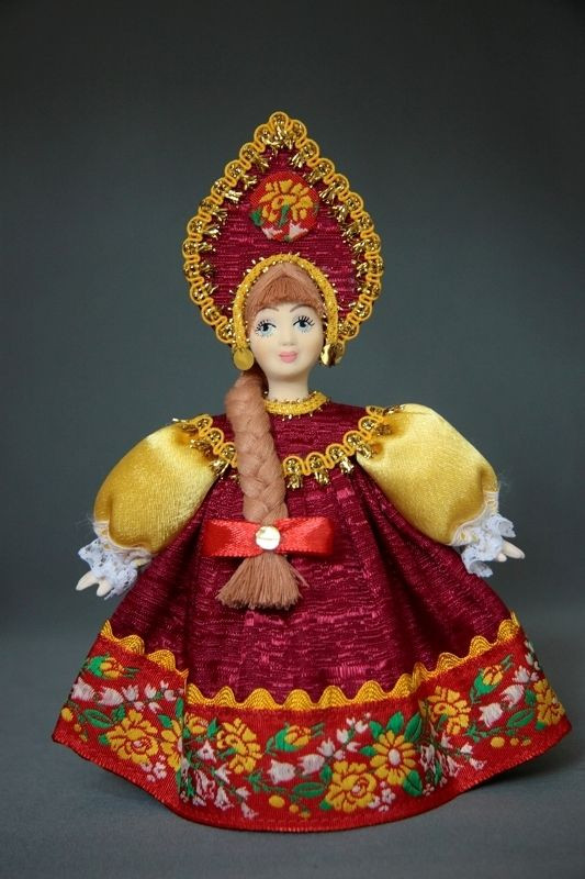 Doll gift. Russian girl in national costume. Russia.