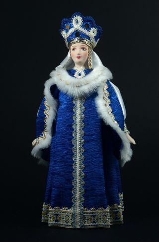 Doll gift porcelain. Boyarynya in traditional winter costume. Russia.