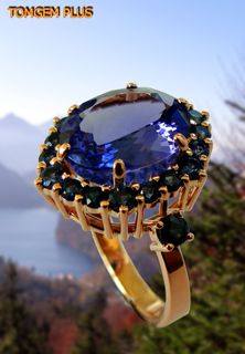 Gold ring 585 with tanzanite 10x12 mm and blue sapphires