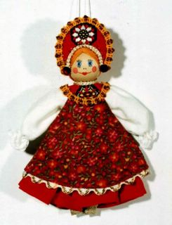 Doll-poteshka gift pendant. Girl in dressy clothes. Wood, textiles,