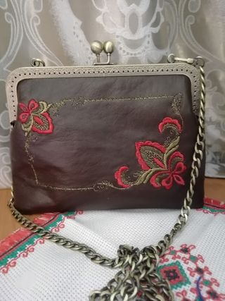 Handbag on a chain made of genuine leather with gold embroidery