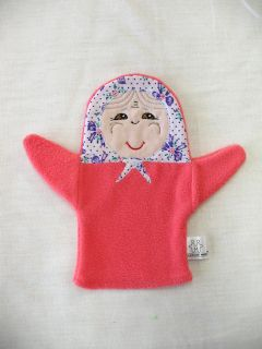 """A doll-glove """"Babka"""" - an educational toy for children from 1 year old"""