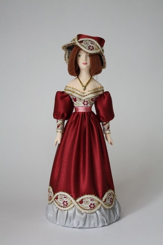 Doll gift porcelain. A lady dressed in European clothes (styling). 19th century.