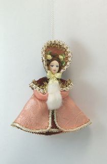 Doll pendant souvenir porcelain. Pushkin era girl with a clutch.