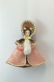 Doll pendant souvenir porcelain. Pushkin era girl with a clutch.