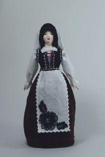 Doll gift porcelain. Jews-Ashkenazi. the city of Kasubke. Holiday women's costume. Late 19th - early 20th century.