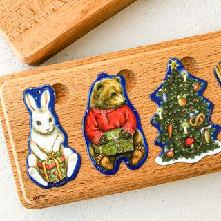 A set of Christmas tree decorations in a wooden case